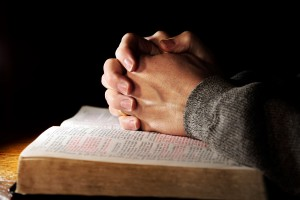 bigstockphoto_Praying_Hands_Man__Bible_2780594-300x200